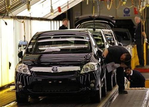 Cars are inspected at the end of the production line at the Toyota factory.