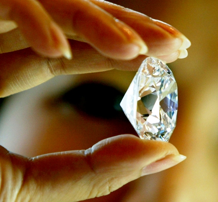 An employee holds the largest D colour internally flawless diamond for auction offered by Sotheby's Geneva in Hong Kong.