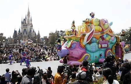 Disney character Mickey Mouse (top) performs atop a float during a parade at Tokyo Disneyland in Urayasu.
