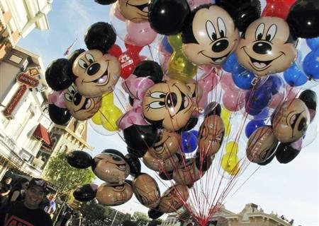 Balloons of Mickey Mouse are carried down main street at Disneyland in Anaheim, California.