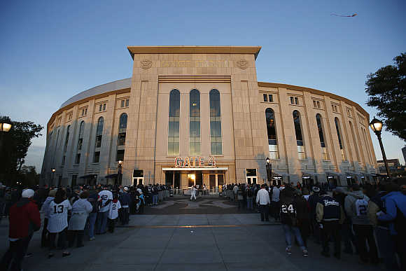 Fans line up to enter Yankee Stadium in New York.