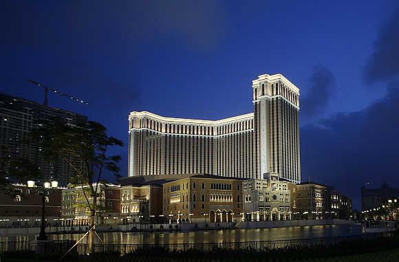 Venetian Macao casino resort of Las Vegas Sands is seen lit up in the evening in Macau.