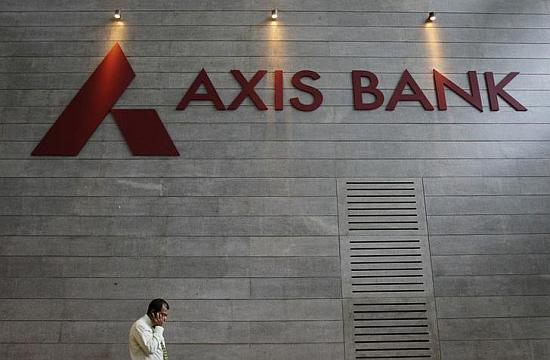 An employee speaks on his mobile phone as he walks inside Axis Bank's corporate headquarters in Mumbai.
