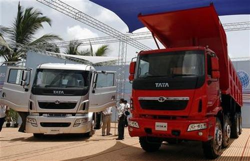 Tata Motors' trucks are displayed during a news conference.
