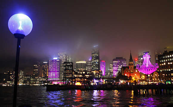 Some of the buildings of Sydney skyline are lighted up in pink as part of the Vivid Festival, Australia.