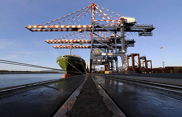 A container ship and cranes at Italy's biggest container port Gioia Tauro in the southern region of Calabria.