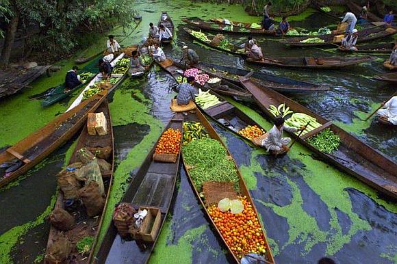 Kashmiri vegetable sellers gather at a floating market on Dal Lake in Srinagar.
