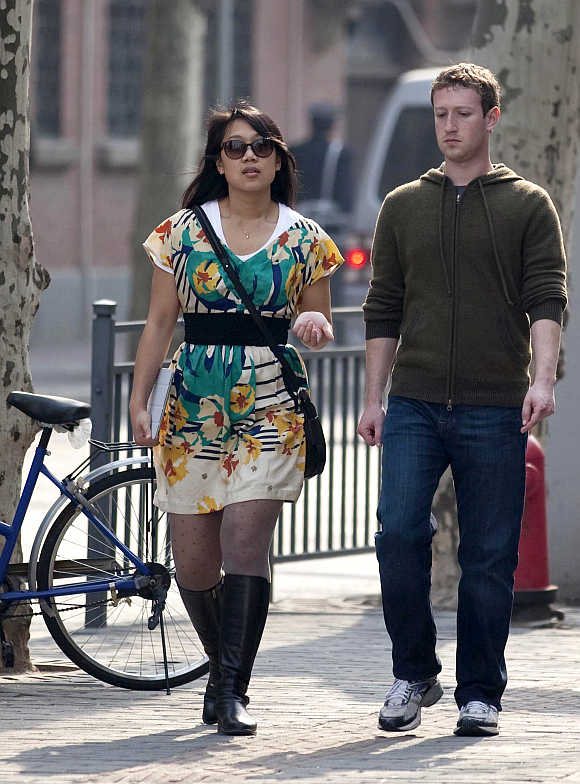 Facebook CEO Mark Zuckerberg with his wife Priscilla Chan walk near Fuxing Road in Shanghai, China.