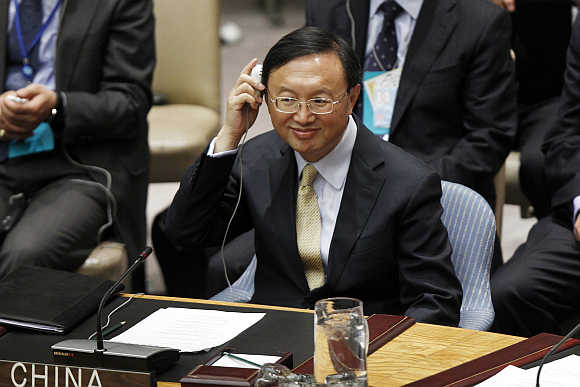 China's Foreign Minister Yang Jiechi listens to translations as he participates in a Security Council meeting in New York.
