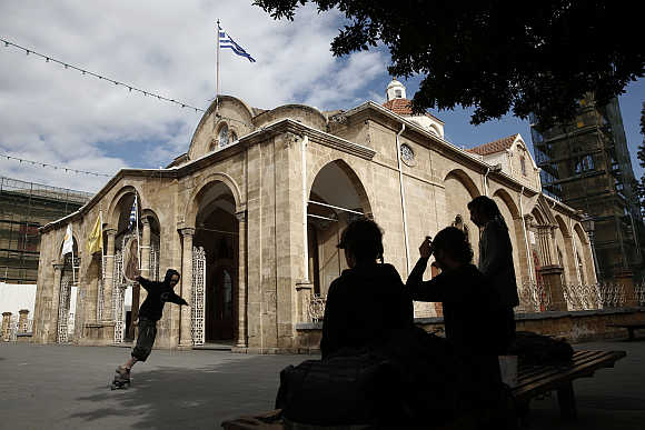 A boy skates in front of the Orthodox Faneromeni church in central Nicosia, Cyprus.