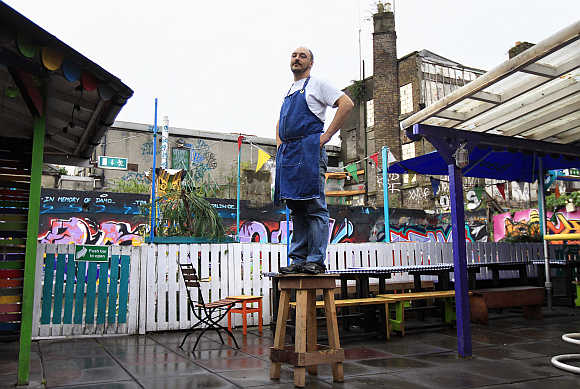 Leandro Virgilio, 37, poses in the backyard of his restaurant near Dublin city centre which becomes a bar and club in the evenings, Ireland.