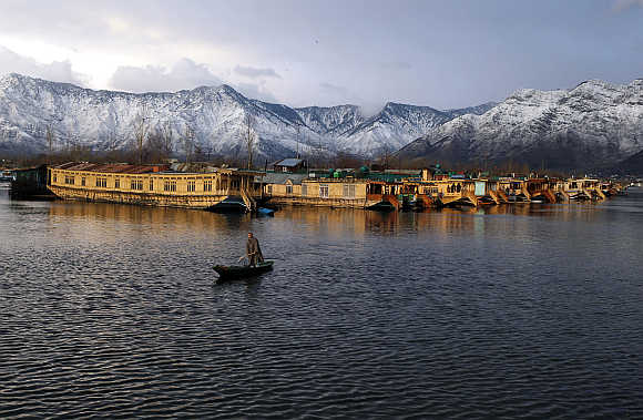 A man rows his boat in Dal Lake in Srinagar, India.