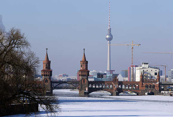 A view shows the cityscape and the frozen river Spree on a cold winter day in Berlin, Germany.