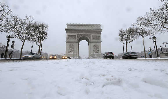 A view of the Champs Elysees avenue and the Arc de Triomphe in Paris, France.