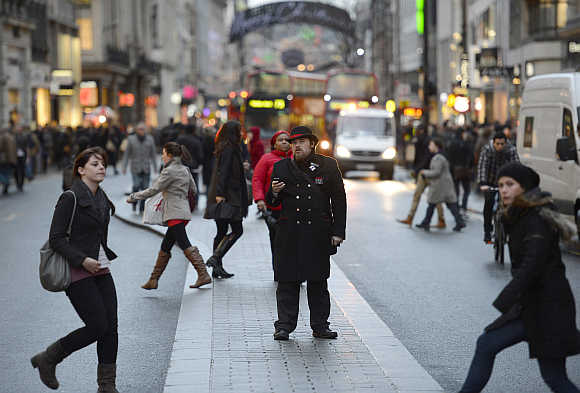 Pedestrians walk along Oxford Street in London, United Kingdom.