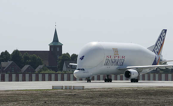 An Airbus Beluga transport plane passes the church of Neuenfelde as it turns at the end of the runway at the Airbus facility in Finkenwerder near Hamburg in Germany.