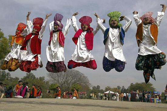 Indian folk dancers perform during the festival of gardens in Chandigarh.