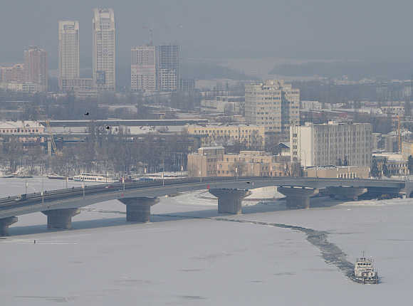 An icebreaker sails along a river in Kiev, Ukraine.