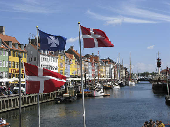 A view of Nyhavn canal, part of the Copenhagen Harbor and home to many bars and restaurants in Denamrk.