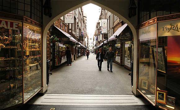 Shoppers stroll through a central Perth arcade in Australia.