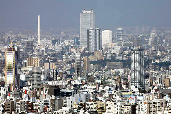 A cluster of high-rise buildings in the Ikebukuro district is seen in Tokyo, Japan.