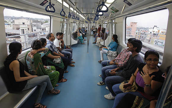 Commuters ride a Metro train in Bangalore, India.