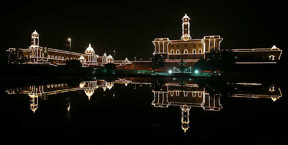 Indian Defence Ministry, left, and Home Ministry, right, buildings are illuminated during the 'Beating the Retreat' ceremony in New Delhi, India.