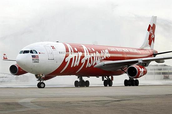 An Airbus A340 AirAsia X passenger jet arrives on its inaugural flight from Kuala Lumpur to Paris.