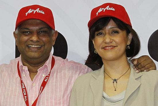 Newly appointed AirAsia's Chief Executive Officer of Malaysian Operations Aireen Omar (R) and Group CEO Tony Fernandes.