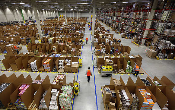 Work is carried out at Amazon's logistics centre in Graben near Augsburg, Germany.