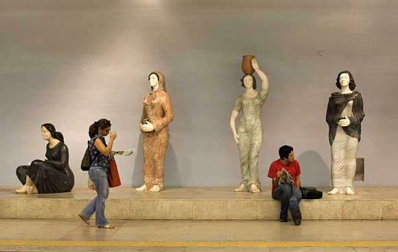 Passengers wait for their trains at Lisbon's subway station in Portugal.