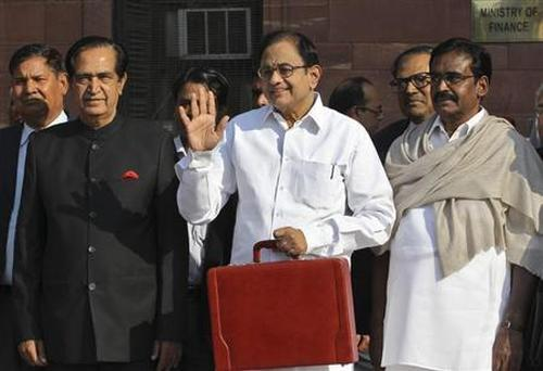 Finance Minister P. Chidambaram (C) leaves his office to present the 2013-14 Union Budget.