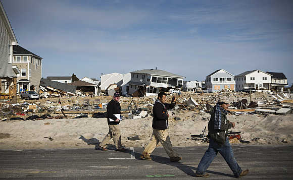 Men survey the damage caused by Hurricane Sandy in the Ortley Beach area of Toms River, New Jersey, United States.