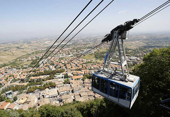 A gondola ascends Monte Titano to the old city of San Marino.