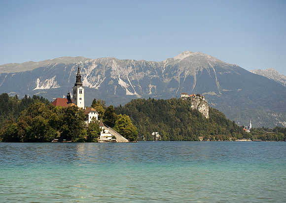 A church on Bled island and a castle are seen on Lake Bled in Slovenia.