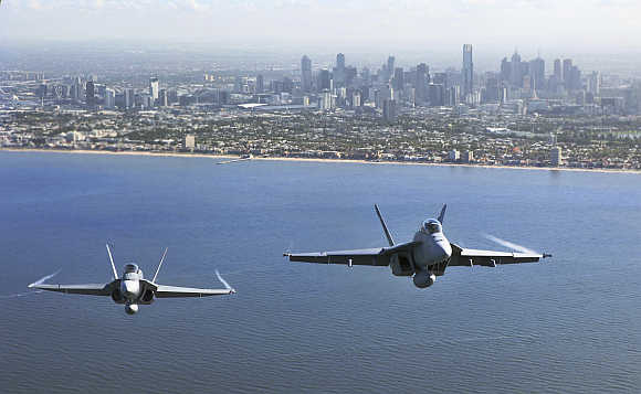Two Royal Australian Air Force fighter jets fly over Port Philip Bay as part of the International Airshow in Melbourne, Australia.