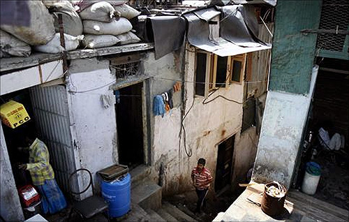People work in their shops in Dharavi in Mumbai.