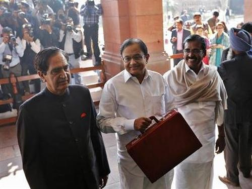 Finance Minister Palaniappan Chidambaram (C) at the parliament before presenting the 2013-14 Union Budget.