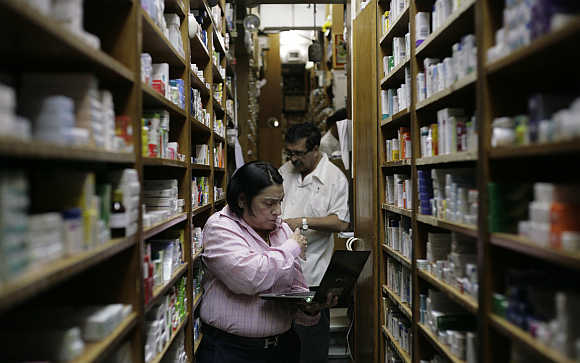 Pharmacy employees check medicine supplies in a drugstore in Caracas, Venezuela.
