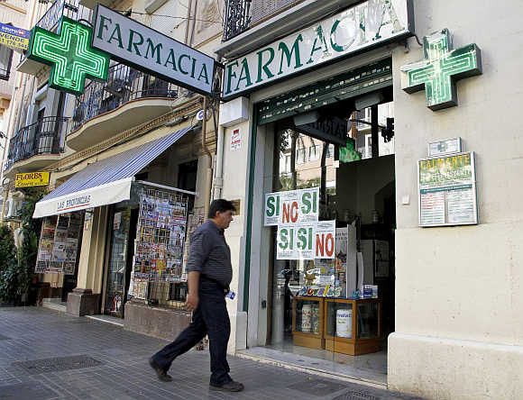 A man enters a pharmacy in Valencia, Spain.