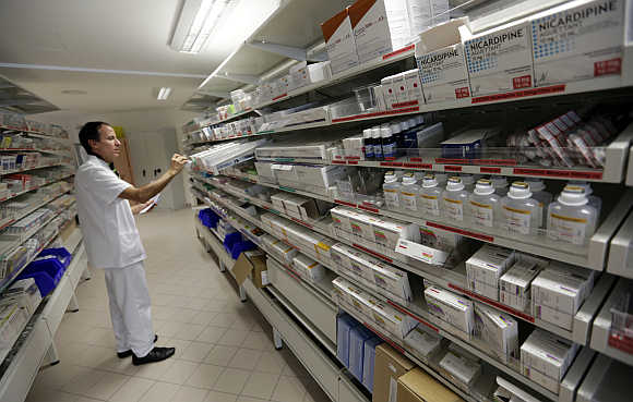 A pharmacist selects drugs in Nice, France.