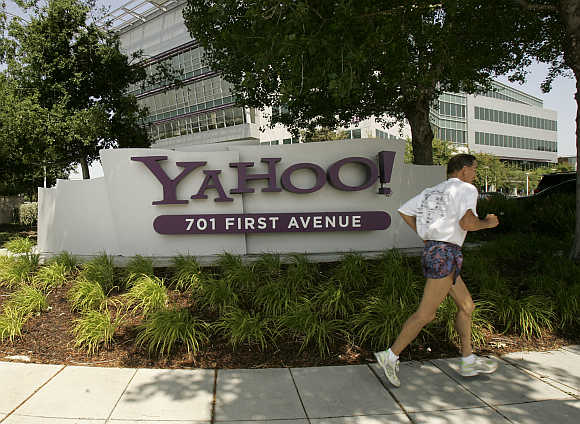 A man runs past the headquarters of Yahoo! in Sunnyvale, California.