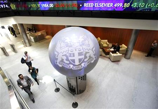 People walk through the lobby of the London Stock Exchange.