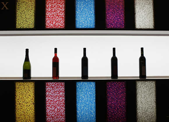Wine bottles are displayed at Alimentaria trade show in Barcelona, Spain.