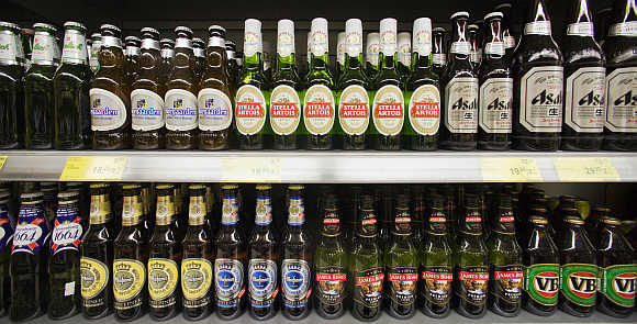 Bottles of beer are displayed for sale at a store in Hong Kong's Sheung Wan district.
