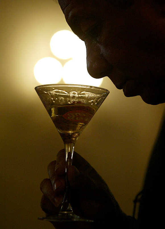 Reinaldo Lopez, Cuban sommelier, tastes a rum cocktail during the International Havana Club Cocktail Grand Prix at Havana's Hotel Nacional