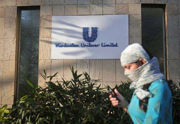 A pedestrian walks past the Hindustan Unilever Limited headquarters in Mumbai.
