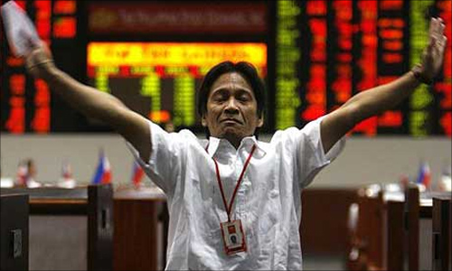 A trader at the Philippines stock exchange as business is halted.