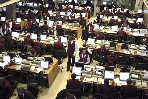 Brokers work on the trading floor of the Nigerian stock exchange in the commercial capital Lagos.