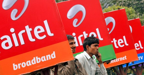 Bharti Airtel billboards along a sidewalk in Kolkata.